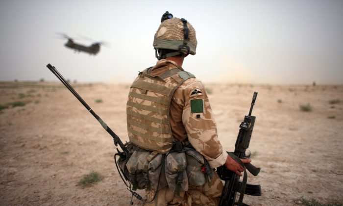A British Army soldier from the 3rd Battalion The Parachute Regiment secures the helicopter landing strip (HLS) during operation Southern Beast in Maywand District, Kandahar Province, Afghanistan, on Aug. 6, 2008. (Marco Di Lauro/Getty Images)