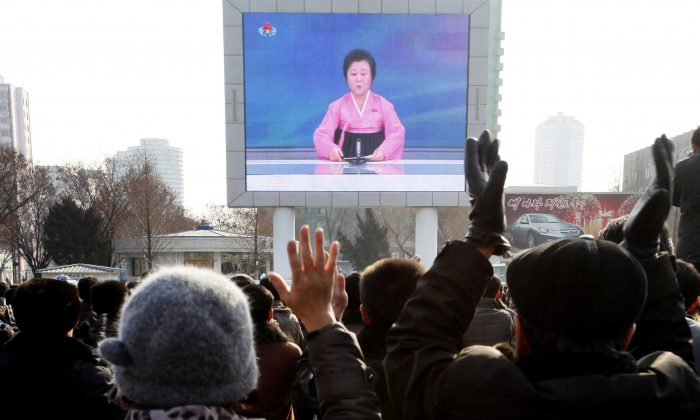 North Koreans watch a news broadcast on a video screen outside Pyongyang Railway Station in Pyongyang, North Korea, on Jan. 6, 2016. Pyongyang has long claimed it has the right to develop nuclear weapons to defend itself against the U.S., an established nuclear power with whom it has been in a state of war for more than 65 years. But to build a credible nuclear threat, the North must explode new nuclear devices—including miniaturized ones—so its scientists can improve their designs and technology. (AP Photo/Kim Kwang Hyon)