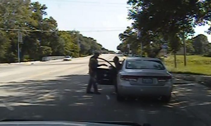 In this July 10, 2015, file frame taken from dashcam video provided by the Texas Department of Public Safety, Texas State Trooper Brian Encinia confronts Sandra Bland after a minor traffic infraction in Waller County,Texas. A grand jury indicted Encinia on Wednesday, Jan. 6, 2016, with the misdemeanor charge. Encinia has been on desk duty since Bland was found dead in her cell in July. Her death was ruled a suicide. (Texas Department of Public Safety via AP, File)