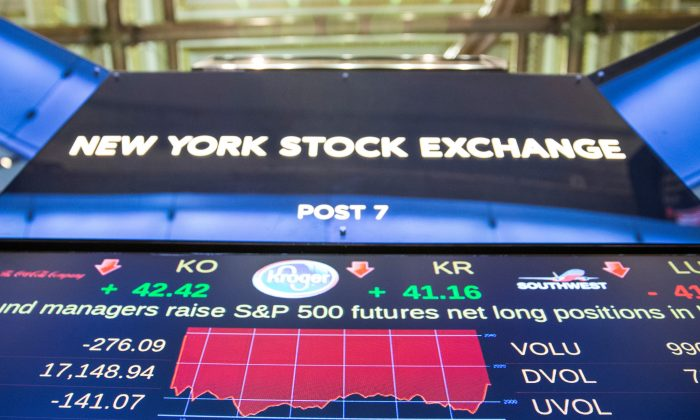 A screen shows the New York Stock Exchange during the afternoon of Jan. 4 the first day of trading for 2016. Despite a rocky start to the year, analysts expect a better year than 2015. (Andrew Burton/Getty Images)