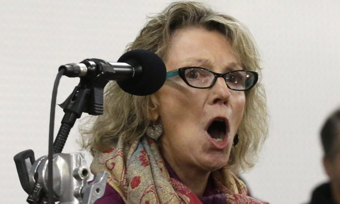 Georgia Marshall, a rancher, expresses her opinion during a community meeting with Harney County Sheriff David Ward Wednesday, Jan. 6, 2016, in Burns, Ore. (AP Photo/Rick Bowmer)