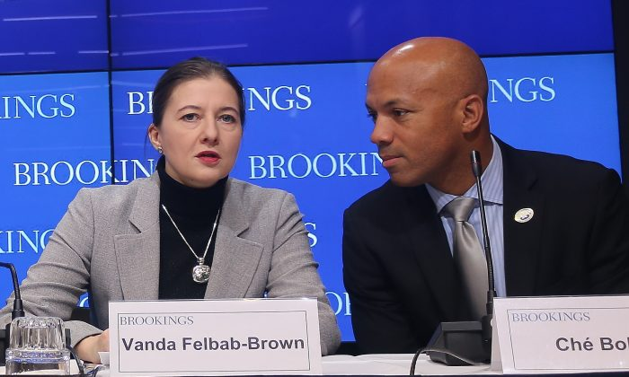 """Vanda Felbab-Brown, senior fellow, Brookings (L), and Ché Bolden, federal executive fellow, Brookings, speak on the """"Stability and human security in Afghanistan in 2016,"""" at The Brookings Institution on Jan. 4, 2016. (Gary Feuerberg/Epoch Times)"""