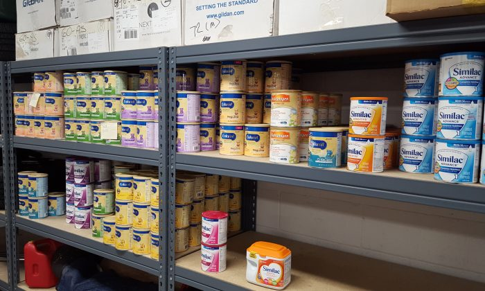 Baby formula seized by police in a file photo. (Logan Police Department via AP)