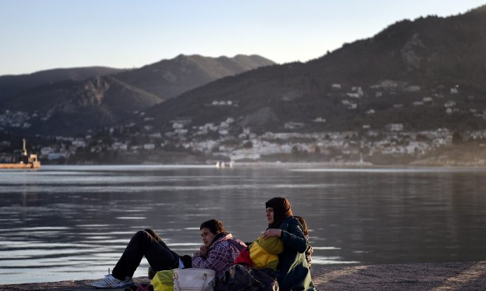 Migrants from Syria wait in the port of Mytilene on the Greek island of Lesbos on Dec. 6, 2015. (Aris Messinis/AFP/Getty Images)