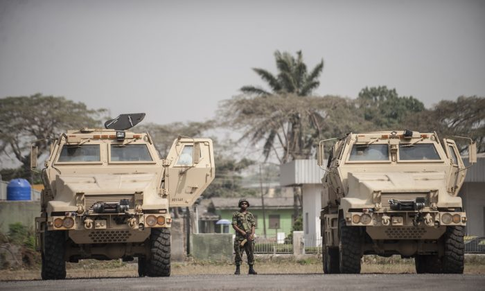 A Nigerian soldier stands between the 24 armoured vehicles donated by the United States to the Nigerian military at the Nigerian Army 9th Brigade Parade Ground in Lagos on Jan. 7, 2016. (Stefan Heunis/AFP/Getty Images)
