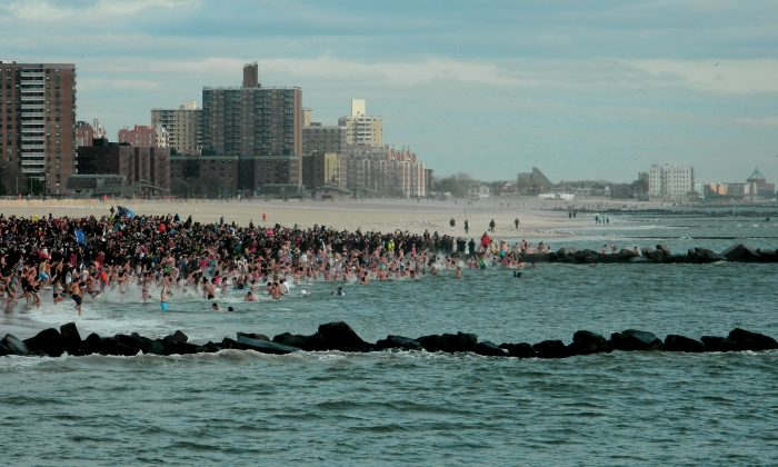 People run into the water in the Polar Bear Plunge in Coney Island, New York City, in Dec. 1, 2016. (Courtesy of Joe Abate)