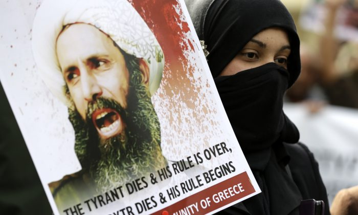 A Shia Muslim who lives in Greece takes part in a rally against the execution of cleric Sheikh Nimr al-Nimr, outside Saudi Arabia's Embassy in Athens on Jan. 6, 2016. (AP Photo/Thanassis Stavrakis)