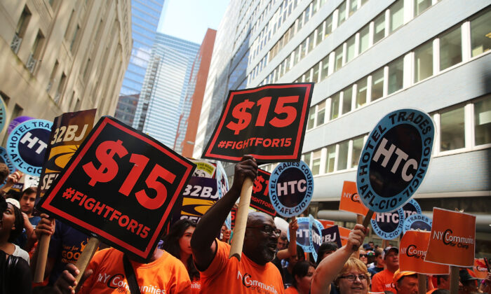 Labor leaders, workers, and activists attend a rally for a $15 minimum hourly wage in New York City on July 22, 2015. (Spencer Platt/Getty Images)
