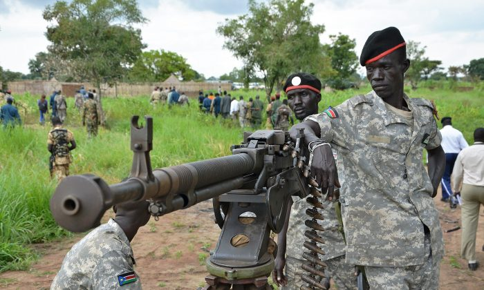 """South Sudanese SPLA soldiers are pictured in Pageri in Eastern Equatoria state on Aug. 20, 2015. The spokesman of SPLA, Colonel Philip Aguer, visited the area after the government claimed to be back in control of the area following an attack by rebel forces. South Sudan's civil war began in December 2013 when Kiir accused his former deputy Riek Machar of plotting a coup, setting off a cycle of retaliatory killings that has split the poverty-stricken country along ethnic lines. The government says they will return to talks in Ethiopia in early September to """"finalise"""" a peace deal. (Samir Bol/AFP/Getty Images)"""