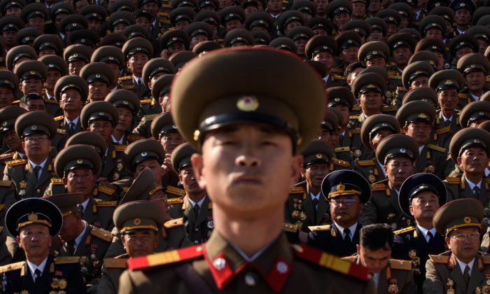 A North Korean soldiers stands before spectators during a mass military parade at Kim Il-Sung square in Pyongyang on Oct. 10, 2015. (Ed Jones/AFP/Getty Images)