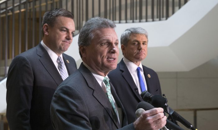 Rep. Buddy Carter (R-Ga.) (C), flanked by House Homeland Security Committee Chairman Rep. Michael McCaul (R-Texas) (R) and Rep. Richard Hudson (R-N.C.), speaks with reporters on Capitol Hill in Washington, D.C., on Jan. 8, 2016, about the arrest of two Iraqi-born men who came to the U.S. as refugees and have been indicted on terrorism-related charges by federal authorities who allege one traveled to Syria to fight with terrorists in the civil war and the other provided support to the Islamic State group. (AP Photo/J. Scott Applewhite)