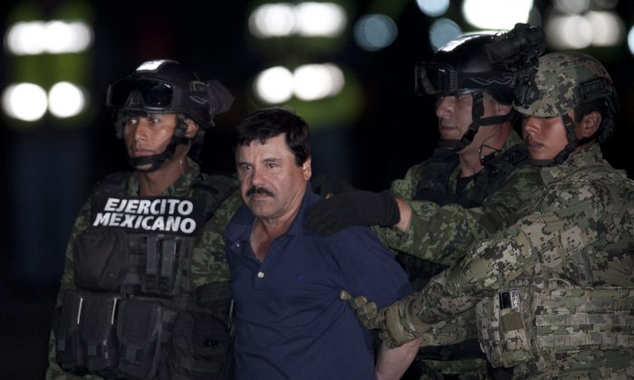 "Mexican drug lord Joaquin ""El Chapo"" Guzman is escorted by army soldiers  to a waiting helicopter, at a federal hangar in Mexico City, Friday, Jan. 8, 2016. The world's most wanted drug lord was recaptured by Mexican marines Friday, six months after he fled through a tunnel from a maximum secuirty prison in a made-for-Hollywood escape that deeply embarrassed the government and strained ties with the United States. (AP Photo/Marco Ugarter)"
