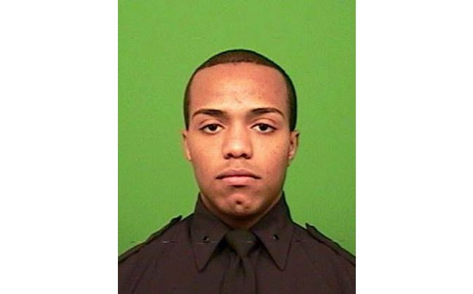 This undated photo provided by the NYPD shows Officer Sherrod Stuart. Authorities say Stuart was shot after exchanging gunfire with a suspect involved in a large fight early Saturday, Jan. 9, 2016. (NYPD via AP)