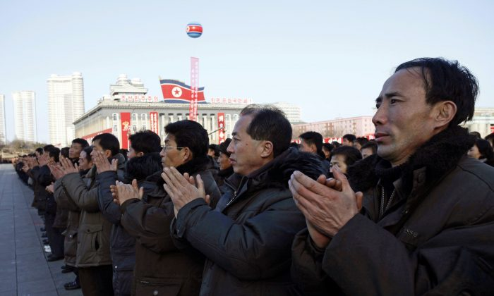 North Koreans clap hands together in a rally, after North Korea said Wednesday it had conducted a hydrogen bomb test, at the Kim Il-Sung Square in Pyongyang, on Jan. 8, 2016. As world leaders debated ways to penalize North Korea's claim of a fourth nuclear test, South Korea voiced its displeasure with broadcasts of anti-Pyongyang propaganda across the rivals' tense border Friday, believed to be the birthday of North Korean leader Kim Jong Un. (AP Photo/Kim Kwang Hyon)