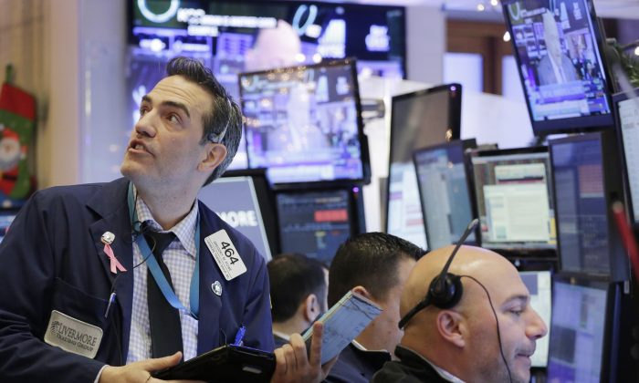 Gregory Rowe (L), with Livermore Trading Group, keeps an eye on stock prices at the New York Stock Exchange on Jan. 8, 2016. A rebound in Chinese stocks helped shore up the mood in global stock markets Friday in the run-up to U.S. jobs data. (AP Photo/Mark Lennihan)
