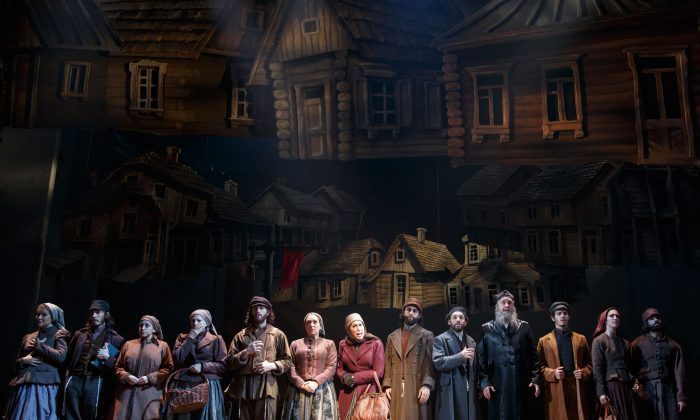 "The cast of ""Fiddler on the Roof"" as the folk of Anatevka, soon to be refugees from their beloved home and way of life. (Joan Marcus)"