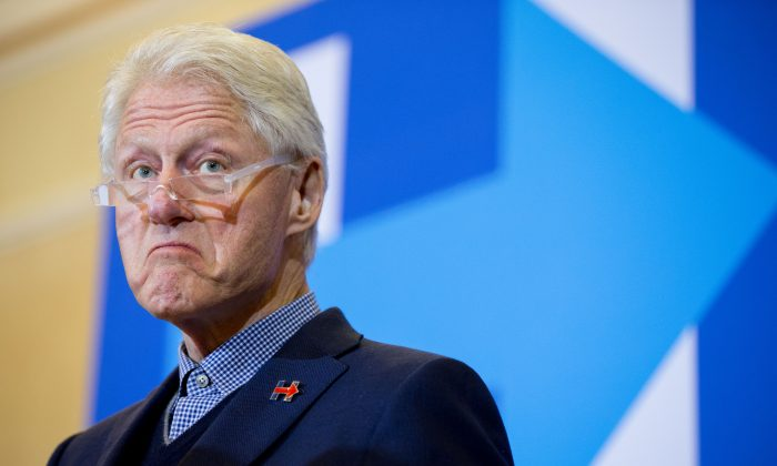 Former President Bill Clinton pauses while speaking during a campaign stop for his wife Democratic presidential candidate Hilary Clinton at Hotel Julien in Dubuque, Iowa, Thursday, Jan. 7, 2016. (AP Photo/Andrew Harnik)