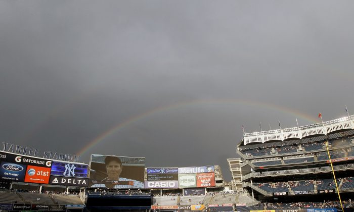 A rainbow is seen over Yankee Stadium during a rain delay before the game against the Tampa Bay Rays on June 7, 2012 in the Bronx borough of New York City. (Jim McIsaac/Getty Images)