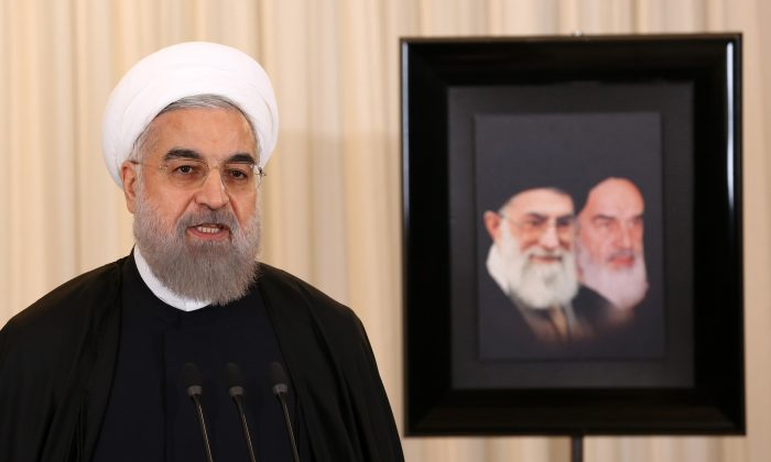 Iranian President Hassan Rouhani at a press conference in his office in Tehran on Dec. 16, 2015. (Atta Kenare/AFP/Getty Images)