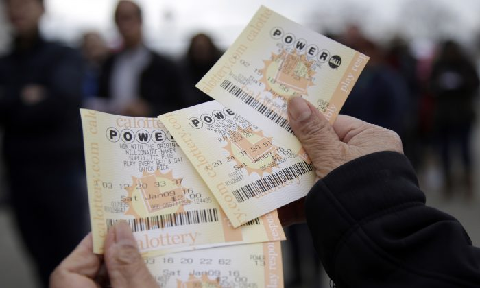 Powerball tickets are shown in San Lorenzo, Calif., on Jan. 9, 2016. No ticket matched all six Powerball numbers following the drawing for a record jackpot of nearly $950 million, lottery officials said early Sunday, Jan. 10, boosting the expected payout for the next drawing to a whopping $1.3 billion. (AP Photo/Marcio Jose Sanchez)