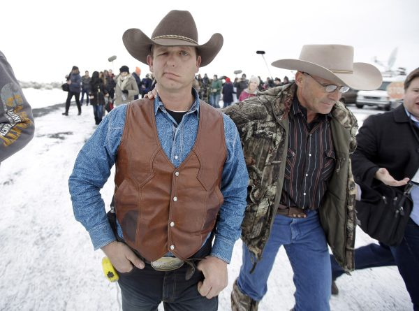 Ryan Bundy, one of the sons of Nevada rancher Cliven Bundy, walks to a news conference at Malheur National Wildlife Refuge near Burns, Ore., on Jan. 7, 2016. A small, armed group occupying the wildlife preserve has said repeatedly that local people should control federal lands, but critics say the lands are already managed to help everyone from ranchers to recreationalists. (AP Photo/Rick Bowmer)