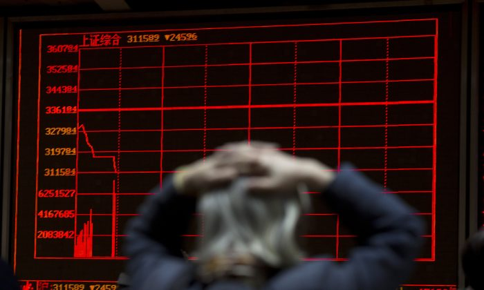 A woman reacts near a display board showing the plunge in the Shanghai Composite Index at a brokerage in Beijing on Jan. 7, 2016. Tumult in China triggered the worst opening week for U.S. stocks in history, and investors could get plenty more to worry about in the following week. (AP Photo/Ng Han Guan)