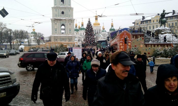 Shoppers crowd an outdoor Christmas market in Kyiv. (Nolan Peterson/The Daily Signal)