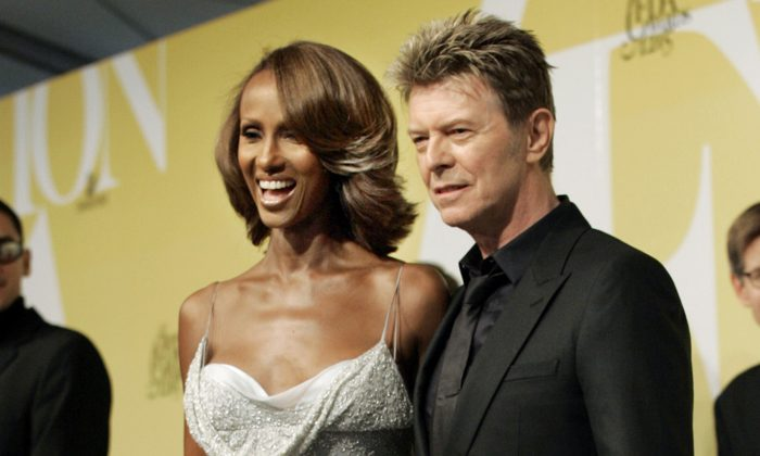 David Bowie and his wife Iman pose at the 2005 CFDA Fashion Awards in New York, June 6, 2005. (AP Photo/Stuart Ramson, File)