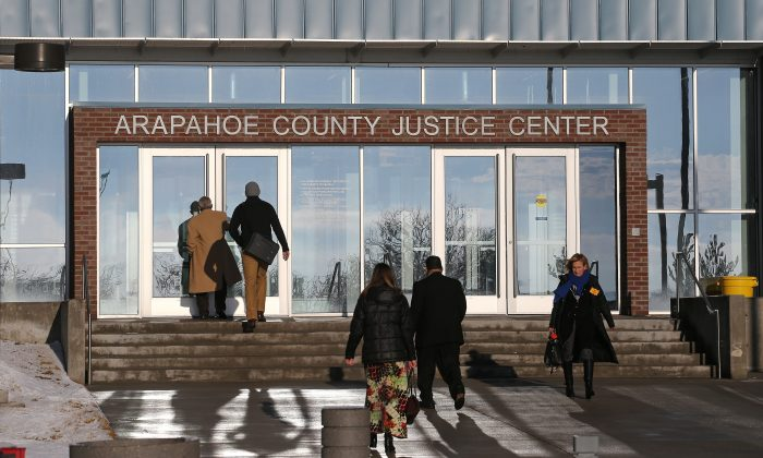 People enter the Arapahoe County Justice Center in Centennial, Colo., on Jan. 20, 2015. Months after the Colorado theater shooting trial, jurors who served said they're still troubled by flashbacks and nightmares, survivor's guilt and hypervigilance that have made it impossible to return to their normal lives. (AP Photo/Brennan Linsley)