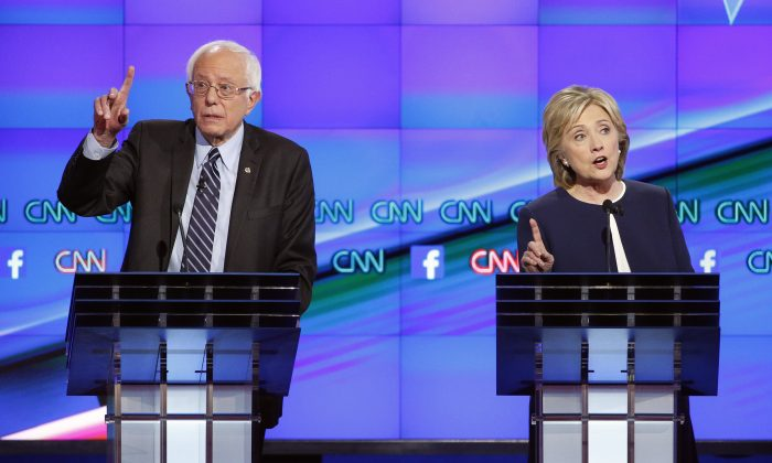 Democratic presidential candidates Hillary Clinton (R) and Sen. Bernie Sanders (I-Vt.) at a Democratic presidential debate in Las Vegas. (AP Photo/John Loche)
