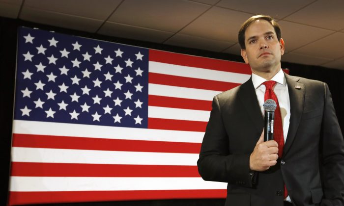 Republican presidential candidate, Sen. Marco Rubio, R-Fla. listens to a question during a town hall campaign stop, Friday, Jan. 8, 2016, in Concord, N.H. (AP Photo/Jim Cole)