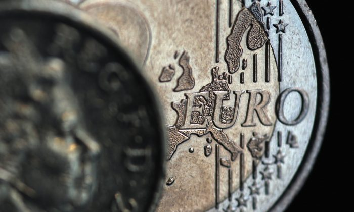 A two euro coin and a GBP1 coin are displayed in London, England, on Nov. 26, 2010. (Dan Kitwood/Getty Images)