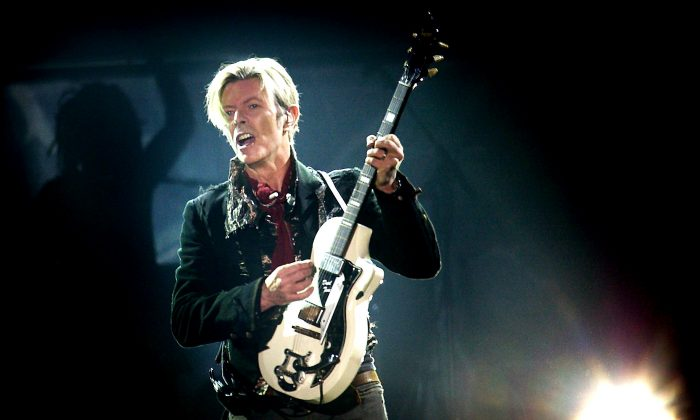 David Bowie on stage at the Forum in Copenhagen on Oct. 7, 2003 during the A Reality Tour. (Nils Meilvang/AFP/Getty Images)