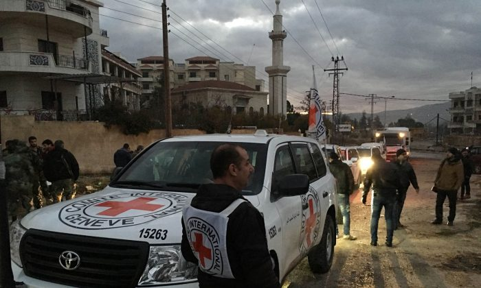 This picture provided by The International Committee of the Red Cross (ICRC), working alongside the Syrian Arab Red Crescent (SARC) and the United Nations (UN), shows a convoy containing food, medical items, blankets and other materials being delivered to the town of Madaya in Syria on Jan. 11, 2016. The town, about 15 miles (24 kilometers) northwest of Damascus, has been blockaded for months by government troops and the Lebanese militant group Hezbollah. Opposition activists and aid groups have reported several deaths from starvation in recent weeks. (ICRC via AP)