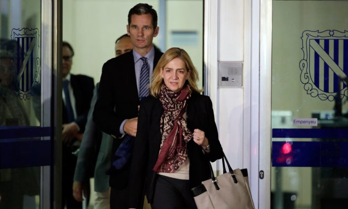 Spain's Princess Cristina and her husband Inaki Urdangarin leave a makeshift courtroom on the first day of a corruption trial, in Palma de Mallorca, Spain, on Jan. 11, 2016. Spain's Princess Cristina spent 12 hours in court Monday at the start of her landmark criminal case, confronting accusations of bankrolling a lavish lifestyle with funds her husband received from an alleged scheme to embezzle millions from public contracts for conferences and sporting events. (AP Photo/Emilio Morenatti)