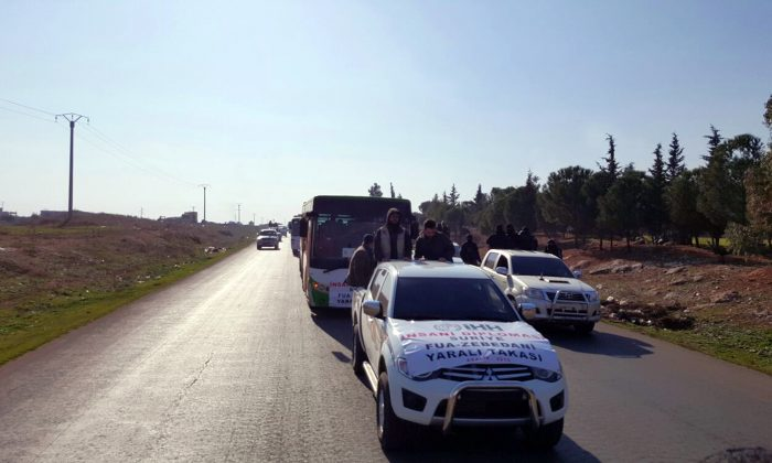 A convoy carrying 338 people evacuated from two Shiite villages in northern Syria heads towards Bab al-Hawa border crossing point with Turkey, in Syria, on Dec. 28, 2015. (IHH via AP)