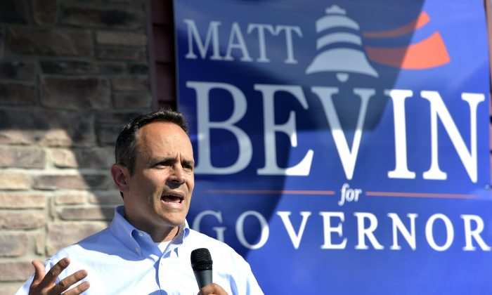 In this Aug. 21, 2015 file photo, Kentucky Republican Gubernatorial candidate Matt Bevin addresses his supporters from the steps of his campaign headquarters in Somerset Ky.  (AP Photo/Timothy D. Easley)