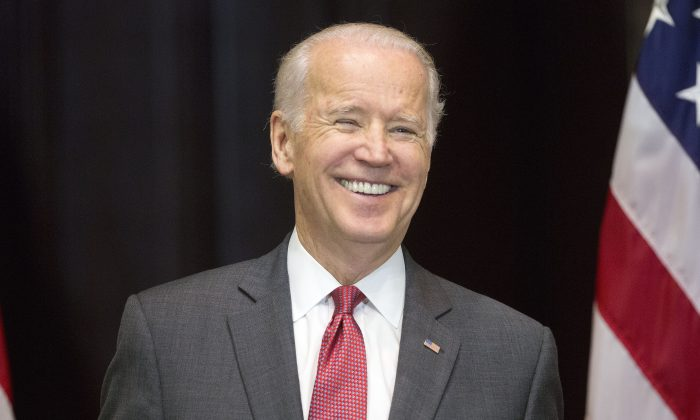 In this Dec. 14, 2015, file photo, Vice President Joe Biden smiles after speaking at an event in Washington. Biden described Bernie Sanders on Monday, Jan. 11, 2016, as more authentic on economic inequality than Hillary Clinton and defended Sanders' record on gun control during an interview with CNN. (AP Photo/Pablo Martinez Monsivais)