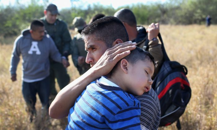 A family illegally crossed the U.S.-Mexico border on Dec. 7, 2015 near Rio Grande City, Texas. (John Moore/Getty Images)