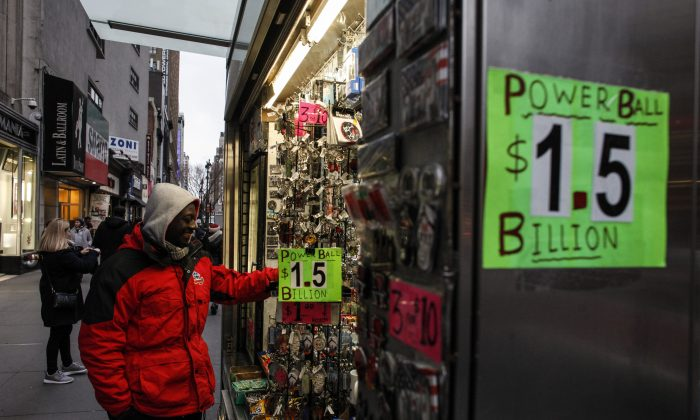 A man buys a Powerball lottery ticket from a stand in New York on January 12, 2016. (KENA BETANCUR/AFP/Getty Images)