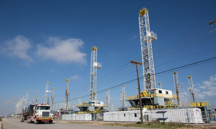 More than 30 oil drilling rigs lay idle in a Helmerich & Payne, Inc. yard in Odessa, Texas, on May 18, 2015. Macquarie Strategist Viktor Shvets thinks technology, too much debt, and adverse government policy are responsible for a bleak future. (Courtney Sacco/Odessa American via AP)
