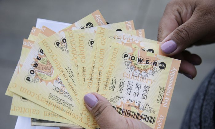 A person shows Powerball tickets she bought in San Lorenzo, Calif., on Jan. 12, 2016. (Marcio Jose Sanchez/AP Photo)