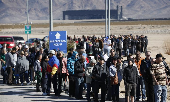 Patrons line up to buy Powerball lottery tickets outside the Primm Valley Casino Resorts Lotto Store just inside the California border, near Primm, Nev., on Jan. 12, 2016. The Powerball jackpot has grown to over $1 billion dollars for the next drawing on Wednesday. (AP Photo/John Locher)
