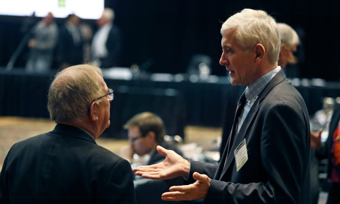 Norwegian anti-doping expert Rune Andersen (R) speaks with Warwick Gendall of New Zealand before a meeting of the World Anti-Doping Agency (WADA) at the Broadmoor Hotel in Colorado Springs on Nov. 18, 2015. Rune Andersen the head of the IAAF taskforce set up to determine whether Russia's ban from global track and field should be lifted says the country is making efforts to reform after its doping scandal. (AP Photo/Brennan Linsley)