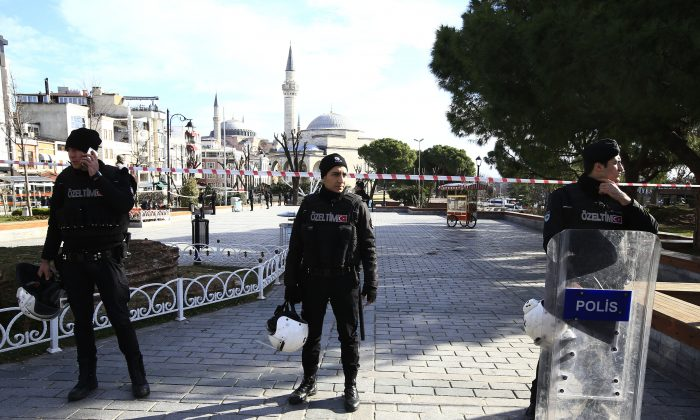 Policemen secure an area at the historic Sultanahmet District, which is popular with tourists, after an explosion in Istanbul on Jan. 12, 2016. (AP Photo/Lefteris Pitarakis)