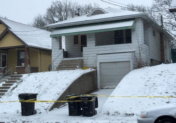 Police tape cordons off a home Tuesday, Jan. 12, 2016, in Cincinnati, where police says a father, who believed he was confronting an intruder in his home, fatally shot his 14-year-old son, who he thought was on his way to school. Authorities said the father called 911 and the boy was taken to Cincinnati Children's Hospital Medical Center, where he died. (Patrick Brennan/The Cincinnati Enquirer via AP)