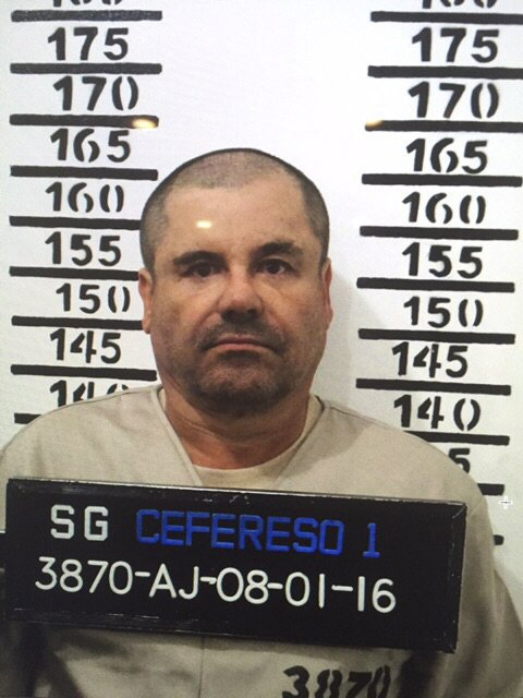 """In this Jan. 8, 2016 image released by Mexico's federal government, Mexico's most wanted drug lord, Joaquin """"El Chapo"""" Guzman, stands for his prison mug shot with the inmate number 3870 at the Altiplano maximum security federal prison in Almoloya, Mexico. (Mexico's federal government via AP)"""