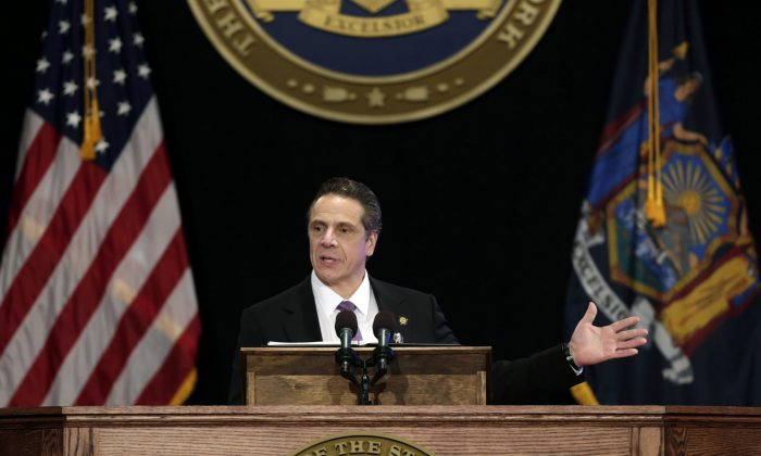 New York Gov. Andrew Cuomo delivers his State of the State address and executive budget proposal at the Empire State Plaza Convention Center, Wednesday, Jan. 13, 2016, in Albany, N.Y. (AP Photo/Mike Groll)