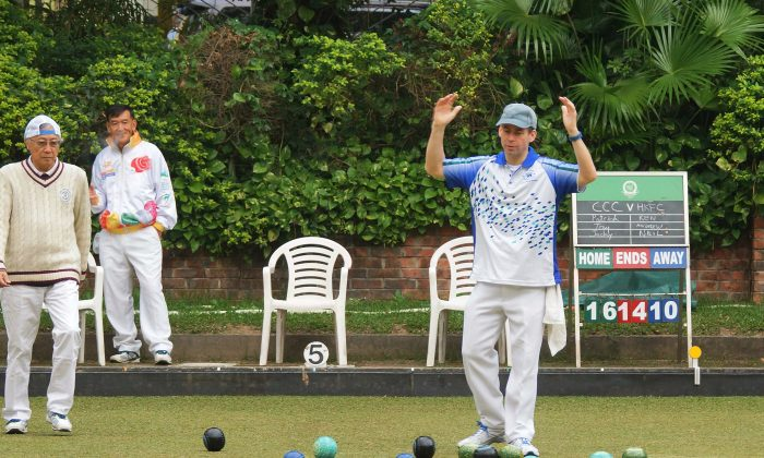 Hong Kong Football Club's Neil Herrington (middle) shows his frustration during the Triples League match against Craigengower Cricket Club-A on Saturday Jan 9, 2016. Despite Herrington losing his match, the team return with a 4-4 draw and remain fifth on the table. (Mike Worth)