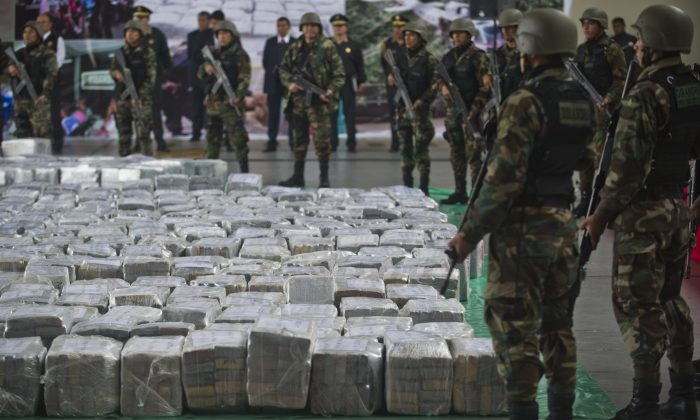 Police officers during the arrival of more than 7 tons of cocaine at the police airport in Lima on Sept. 1, 2014. (Ernesto Benavides/AFP/Getty Images)